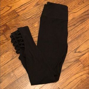 Nine West black leggings with ankle cut outs.